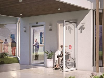 Exterior entrance of elderly home with swing door system