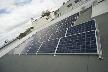 A roof-mounted solar photovoltaic system achieves a 13% reduction on operational carbon emissions