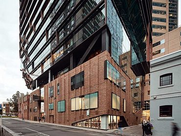 An inclined glass face gives the heritage building breathing space