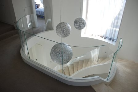 residential staircase curved glass banister