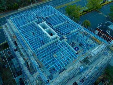SBS Group supplied prefabricated top level wall and roof truss framing