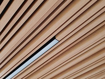 Detailed facade image of Covet concealed fix system Kabebari timber look battens