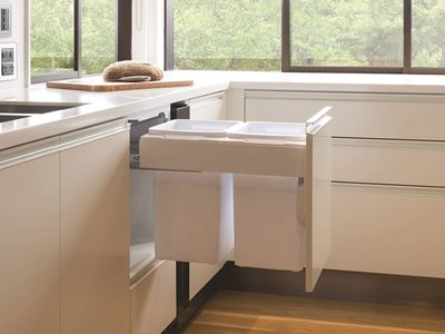 Modern white kitchen interior with under counter bins