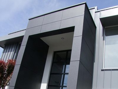 Building exterior with performance coating