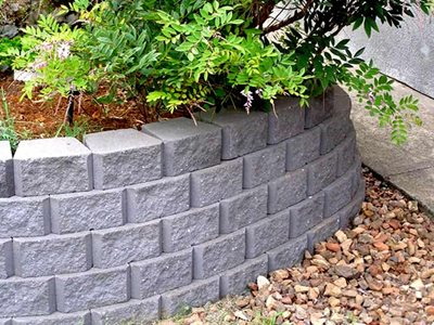 Detailed image of masonry blocks used for garden bed edging