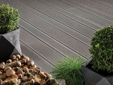 Residential decking surrounded by potted plants