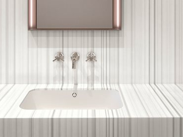 White modern bathroom basin with bronze mirror