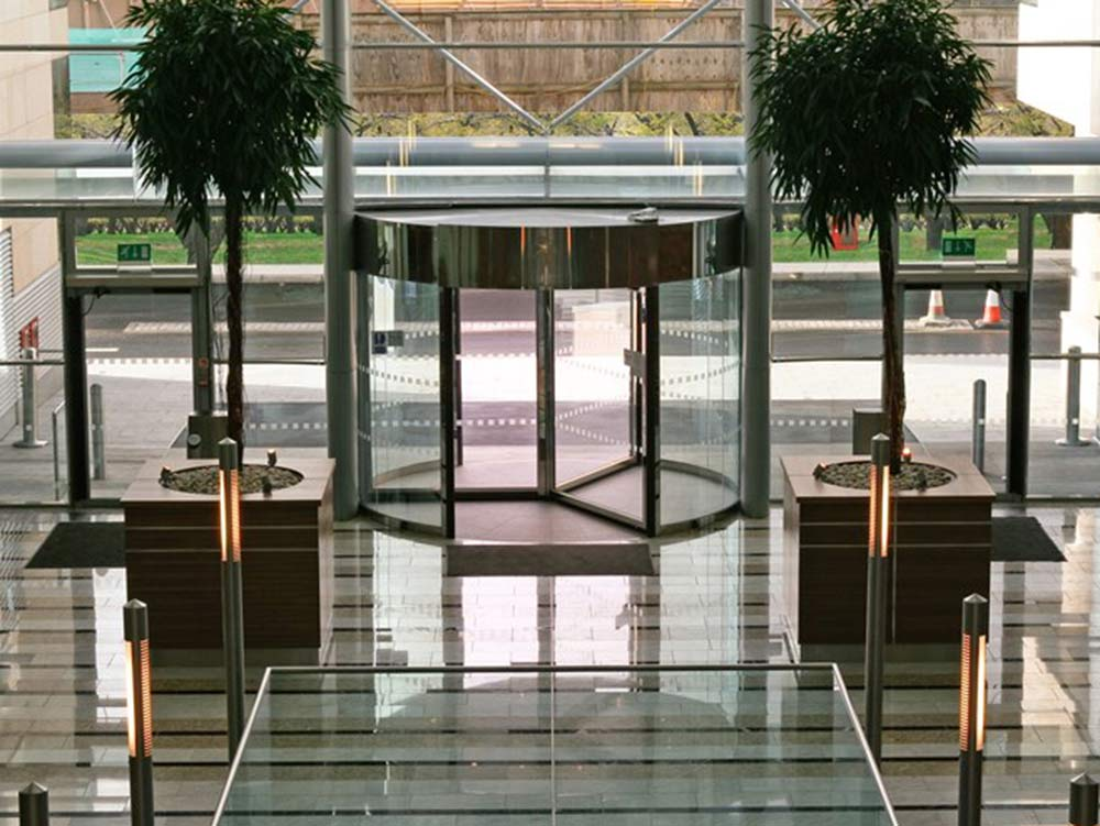 Interior of corporate building with revolving door entrance