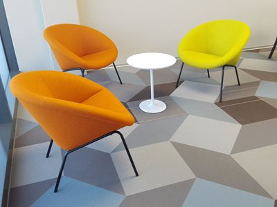 Armstrong Woven Vinyl Flooring with Diamond Tiles in Office Interior with Orange Chairs