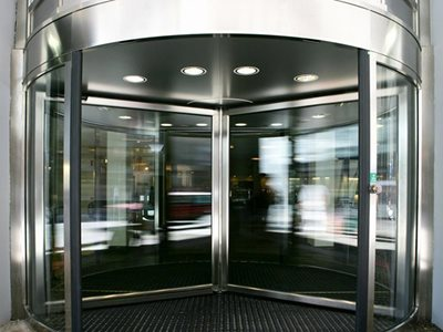 Detailed image of revolving door of building entrance