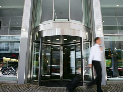 Close up of building exterior with revolving doors