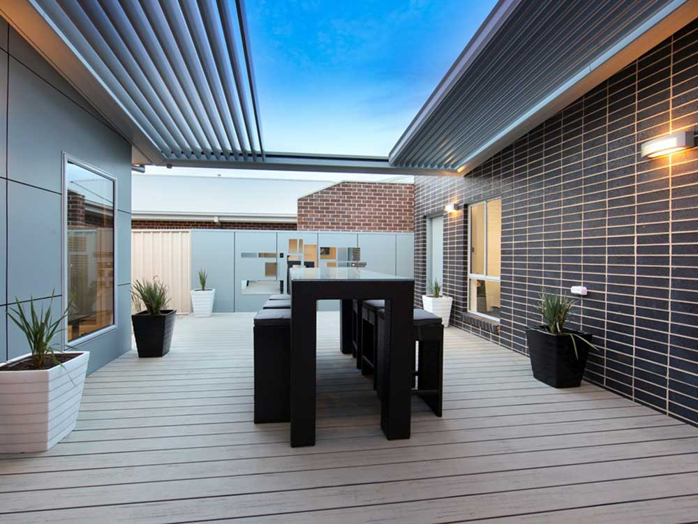 Modern outdoor patio with retractable louvre sunshade system