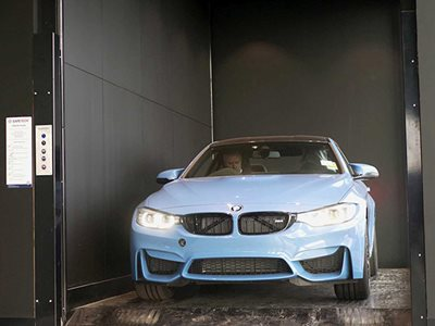 Safetech vehicle lift in BMW showroom