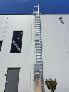AM BOSS access ladders fall protection system Ladline on building exterior