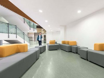 Highly durable and customisable wall and flooring products in commercial corporate building