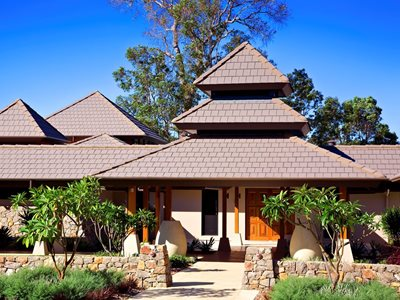 Exterior view modern Asian inspired home with terracotta roof tiles
