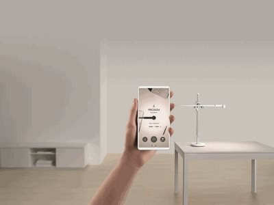 Insitu Dyson CSYS Task Light app hand holding white phone