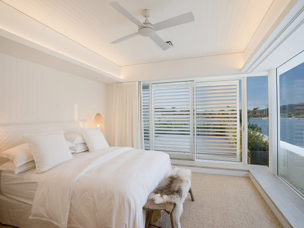 White bedroom interior with plantation shutters