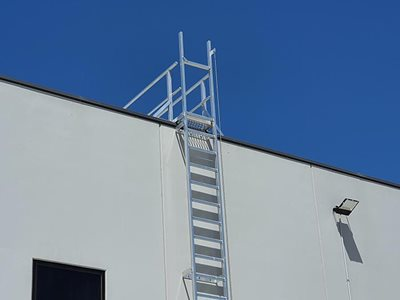 AM BOSS access ladders fall protection system Ladline on side of building
