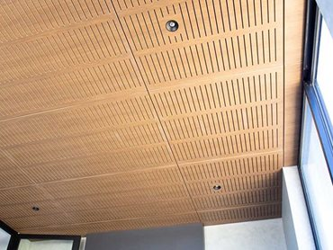 Key-Nirvana Classic Walnut acoustic ceiling tiles were chosen for their noise reduction capabilities as well as the all-natural finish