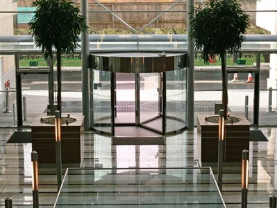 Interior of high rise building with revolving door entrance