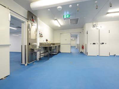 Interior of healthcare operating room with blue resin-based flooring