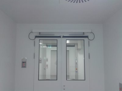 Health center interior with swing door system