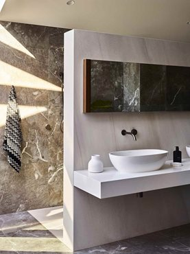 Modern bathroom interior with marble walls and flooring