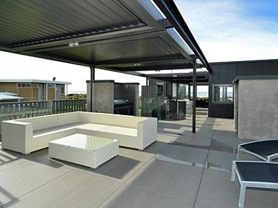 Award winning home featuring 180 Linear Louvretec opening roofs