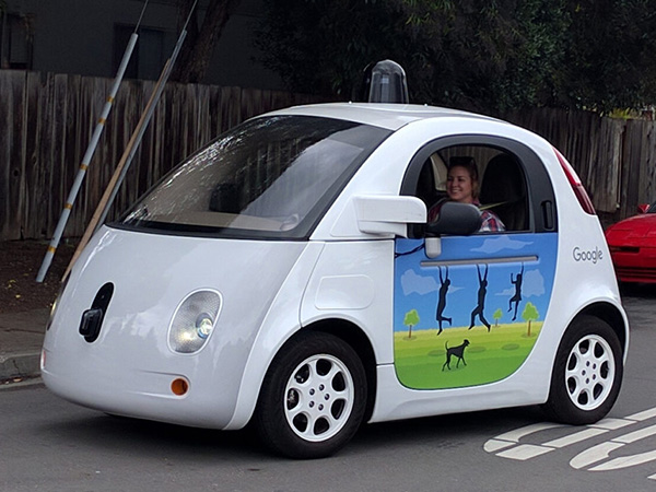 Driverless vehicles and pedestrians don't mix. So how do we re-arrange our cities?