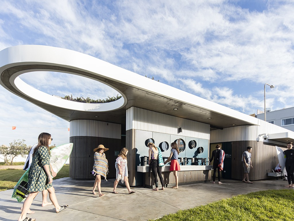Chamfered corners, green roof and circle motifs soften impact of new North Bondi Amenities