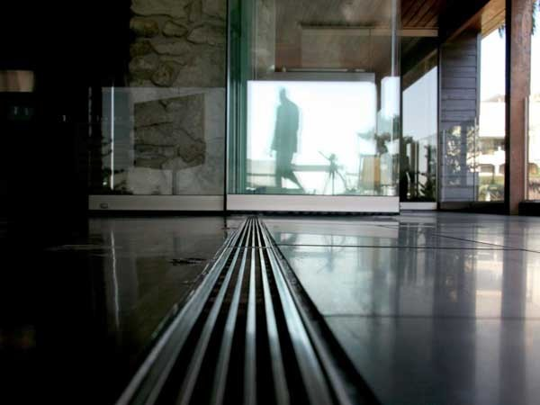 Linear drainage systems add a striking visual statement to any setting