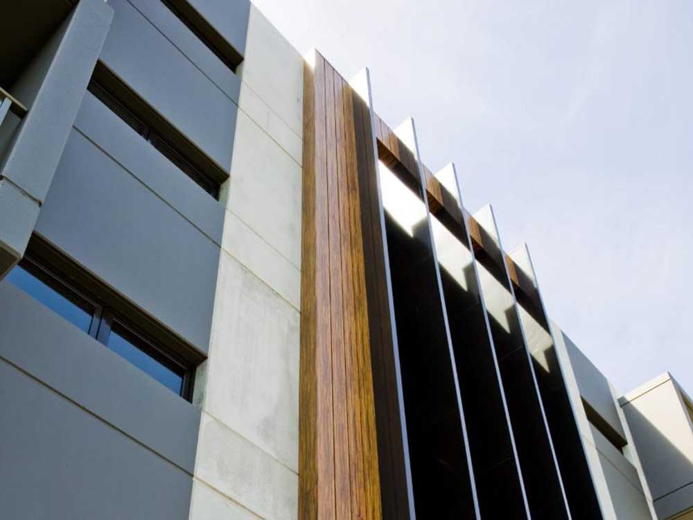 Stryüm range of woodgrain finish aluminium facade panels