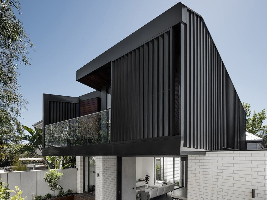 Sleek, contemporary addition to an old weatherboard home