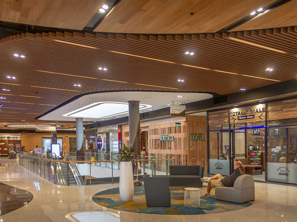 Interior view of retail center with MDF slat ceiling system