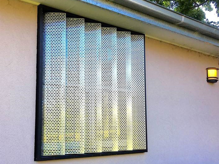 Novel shutters used on exterior window of residential building