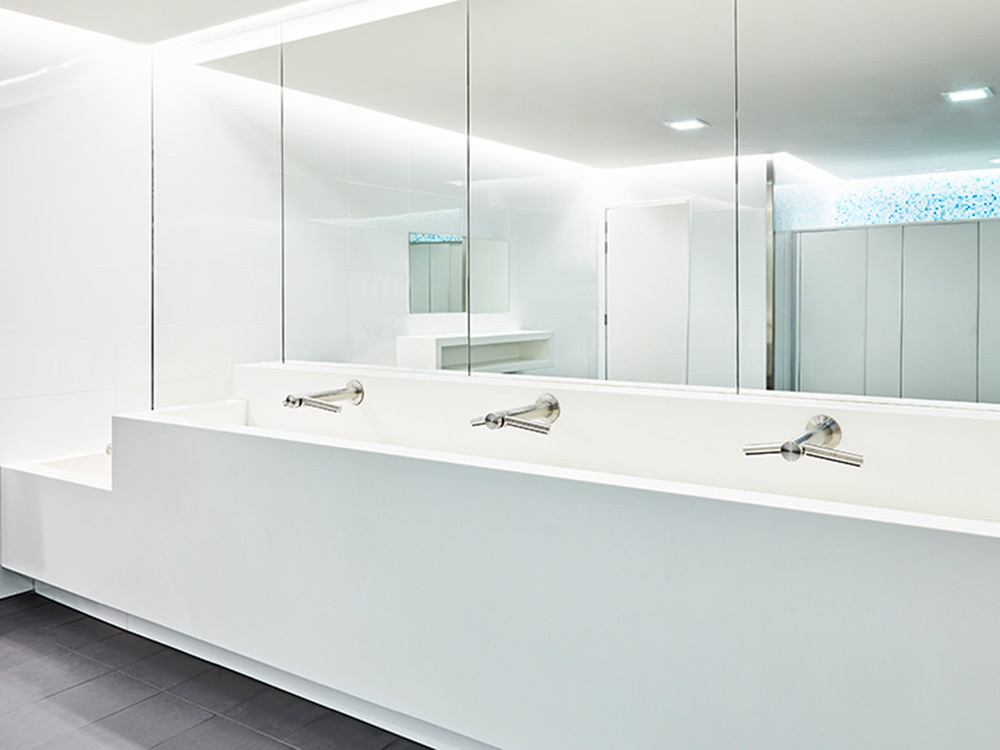 Interior view of public washroom featuring Dyson taps and hand dryers