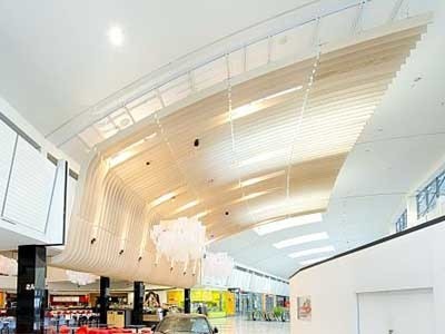 The stunning curved linear batten feature ceiling at Rhodes Waterside foodcourt