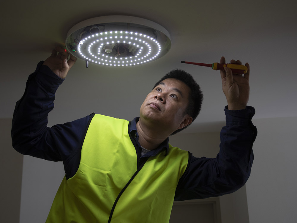 Dr Wen Hu of UNSW at the new residential apartment complex in Castle Hill, testing the EMIoT wireless platform. Image: Quentin Jones/UNSW.