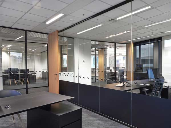 Exposed ceilings and glass partitioning were selected to provide an open airy feeling