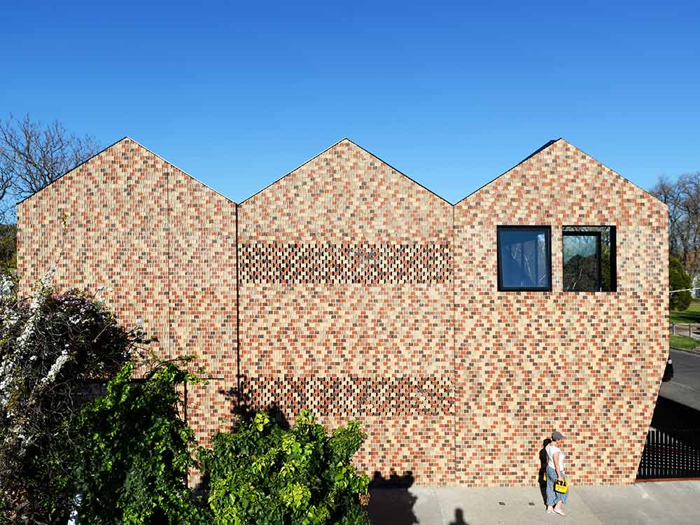 External facade of residential building with non-combustible clay bricks