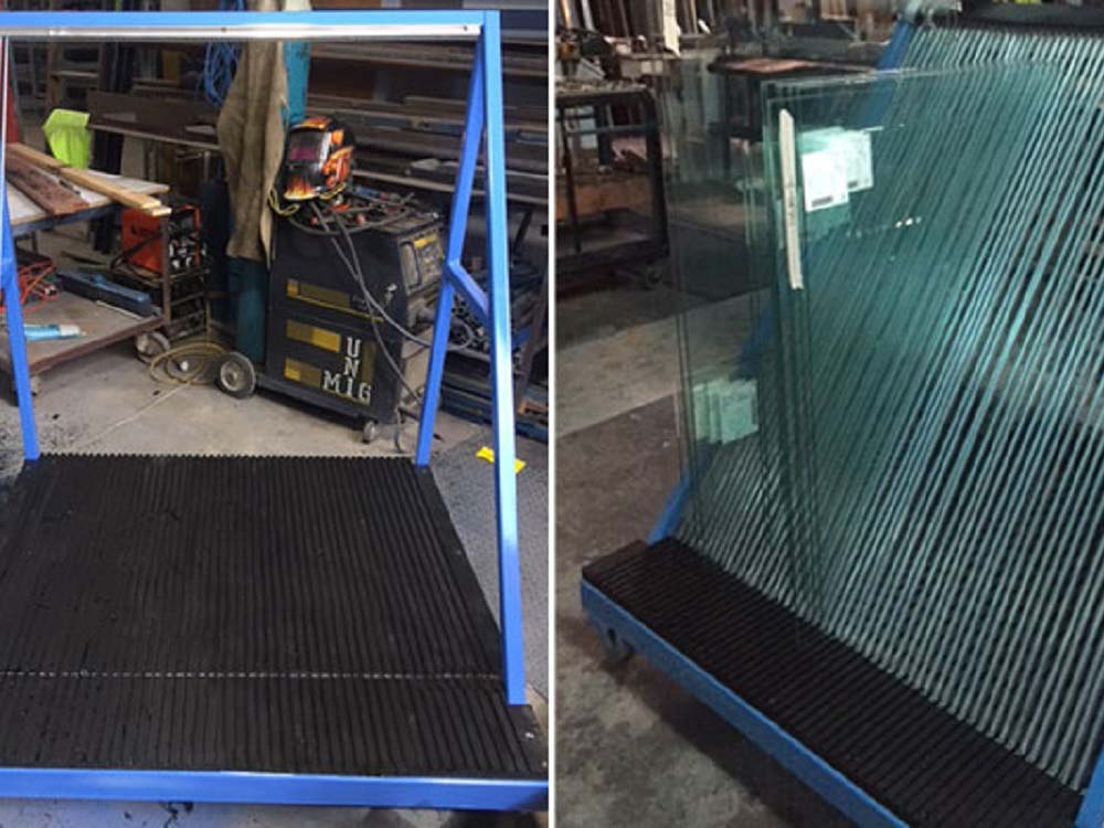 Black HDPE panels with CNC routed grooves for safe glass handling