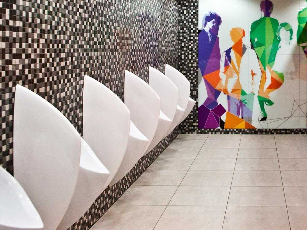 Uridan waterless urinals with privacy screens