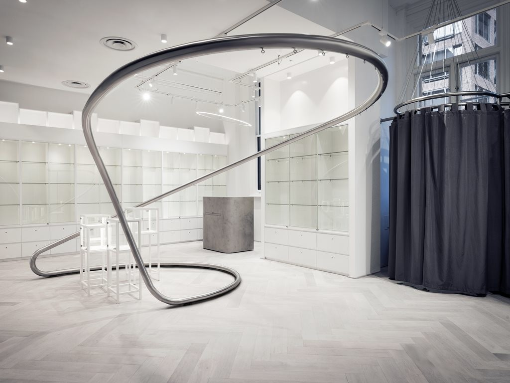 Loopcreative design custom sculptural steel clothing rack for fashion store