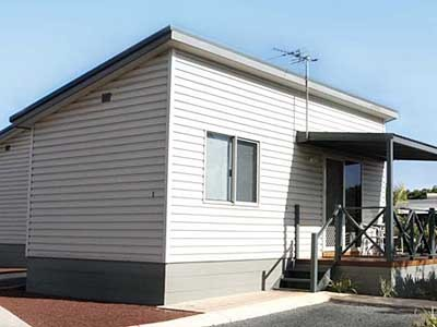 Vinyl cladding is a popular and economical choice for granny flat exteriors