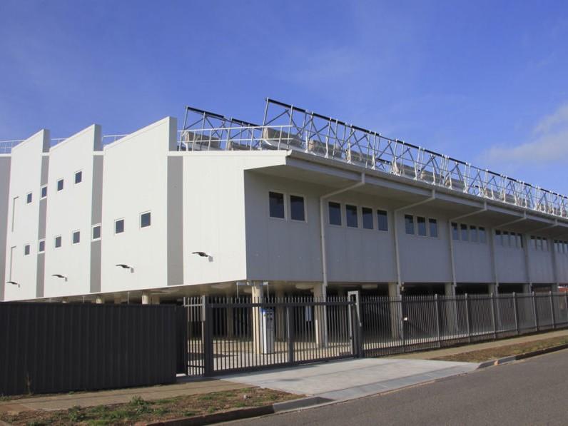 A four-storey office building powered by a combination of thermal and PV solar and wind energy in South Australia has cut its connection to the electricity grid in what its owners claim to be a world first. Image: Supplied